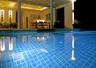 pool and house on samui at night